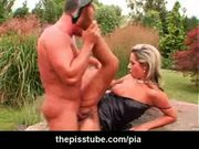 Piss soaked couple in outdoor fucking action