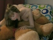 Sexy girl fucks a teddy-bear