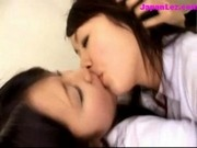 2 Schoolgirls Kissing Passionately On The Bed