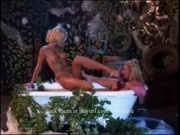Blond lesbians finger fuck in a tub