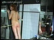 Horny milf slave with her nipples and clit pierced is spanke