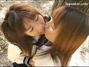 2 Schoolgirls In Uniform Kissing Passionately In The Forest