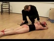 Girl With Collar Tied Legs Whipped By Master On The Floor