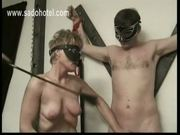 Older slave jerks-off other slave while playing with her own