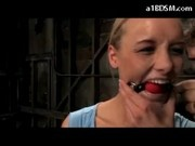 Blonde Girl Mouthgagg Tied Arms Getting Her Pussy Fignered Stimulated With Vibrator In The Dungeon