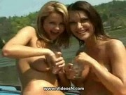 Two girls having fun on boat trip
