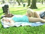 Blond lesbians masturbate in the park
