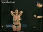 German master puts wooden clamps on large tits covered in ca
