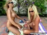 Two lesbian MILFs taking a sunbath