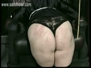 Horny nun slave is bend over a chair by a priest and spanked