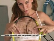 A sexy girl is playing tennis