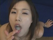 Japanese bukkake cutie drools and plays with cum