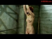 Redhead Girl Standing With Tied Arms Mouthgagged Whipped By Master In The Dungeon