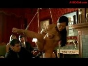 Asian Girl Bondaged Standing On One Leg Getting Her Pussy Stimulated With Vibrator Whipped In The Lo