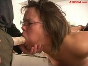 Hogtied Girl With Glassed Getting Her Mouth Fucked With Strapon By Master On The Desk