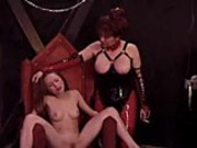 Mistress Tara ties her down and whips her pussy