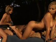 Two lesbian teens play with toys