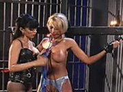 Gothic whore enjoys spanking her blonde slave with a riding crop