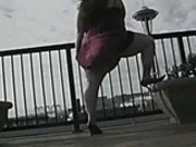 Mandy masturbates in her balcony