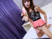 Cute ladyboy tgirl masturbates her hard cock on the bed