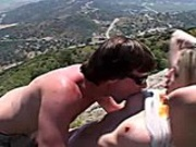 Tall blonde is fucked hard on the mountain by a young horny guy