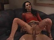 Wild brunette in red fishnets gets ass pumped full of dick