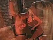 Horny dominatrix enjoys tieing up and spanking this bitch of a guy