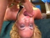 This horny blonde gags in tears and gets sprayed with semen