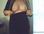 Curvy chick flashes her big tits