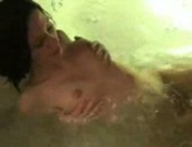 Beautiful amateur playing in the water
