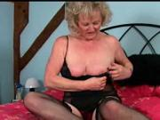 Mature woman masterbating