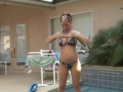 hot girl does striptease by pool