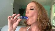 horny redhead plays with her clit