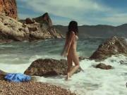 Nadina L spreads legs and masturbates by the sea