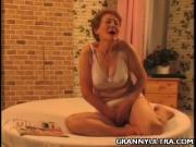 Naughty Grandma Strokes Her Boobs  Pussy