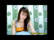 Hot oriental teen has a pretty little dress