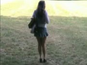 Teen plays with a vibrator outdoor