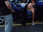 Dogging wife entertains a group outdoors