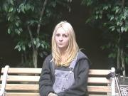 Petite blonde strips and masturbates on the bench