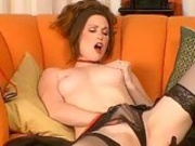 Slutty brunette Aimee Sweet gets too hot to handle touching herself on the couch