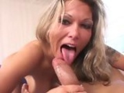 Anna Nova wraps her hand and lips around the shaft of a huge cock