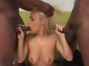 Mia Bangg sucks off 2 black cocks then gets fucked hard by both