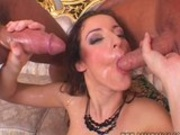 Lovely babe Judith Fox gets double sprayed with fresh cum on her mouth