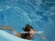 Two chicks fucking in the pool.
