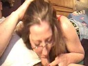 Mature woman sucking long cock