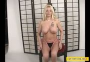 Busty MILF masturbating for money