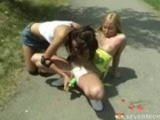 Teen lesbians play with each other on bike path