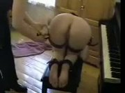 Shackled piano slave gets her wet pussy chained