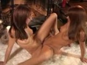 Charlie Laine and her friend pleasuring themselves next to the fireplace