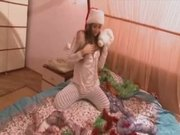 Cutie Santa girl teasing on the bed